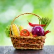 Fresh vegetables in the basket on wooden table — Stock Photo #24179963