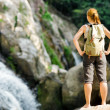 Female hiker looking at waterfall — Stock Photo #24179969
