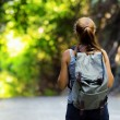 Young woman hiking with backpack — Stock Photo #25556871