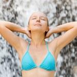 Young woman relaxing in waterfall — Stock Photo #25557015