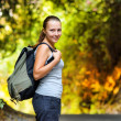 Stock Photo: Young woman hiking with backpack