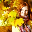Young woman in autumn park. — Stock Photo #26329251