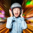 Stock Photo: Funny girl in helmet moving on the street