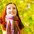 Stock Photo: Young woman in autumn park.