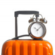 Alarm clock on orange suitcase — Stock Photo