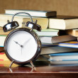Stock Photo: Alarm clock and books. Education concept