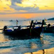 Traditional thai boats at sunset beach — Stock Photo #29027767