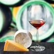 Glass of wine and cheese in winery — Stock Photo