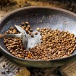 Coffee beans are roasting in pan. Traditional techniques — Stock Photo