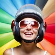 Funny girl in helmet having fun. Multicolored background — Stock Photo