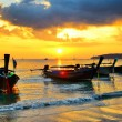 Traditional thai boats at sunset beach — Stock Photo #31110099