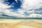 Beautiful sky and beach at low tide — Stock Photo