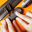 Woman locked her luggage in the orange suitcase — Stock Photo