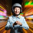Funny girl in helmet moving on the street — Stock Photo
