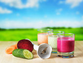 Vegetable smoothie on wooden table on the rural background — Stock Photo