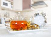 Teapot of fresh tea in a kitchen — Stock Photo