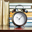 Alarm clock and books. Education concept — Stock Photo #31870967