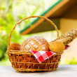 Fresh bread in the basket on natural background — Stock Photo