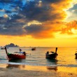 Traditional thai boats at sunset beach — Stock Photo #31871419