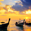 Traditional thai boats at sunset beach — Stock Photo