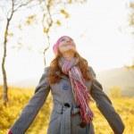 Young woman enjoying fall season. Autumn outdoor portrait — Stock Photo #32385885