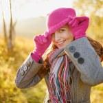 Young woman enjoying fall season. Autumn outdoor portrait — Stock Photo
