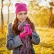 Young woman enjoying the fall season. Autumn outdoor portrait — Stock Photo #32385999
