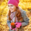 Young woman enjoying the fall season. Autumn outdoor portrait — Stock Photo #32386043