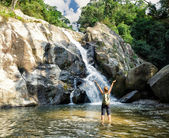 Female hiker looking at waterfall — Stock Photo