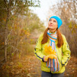 Young woman walking in the fall season. Autumn outdoor portrait — Stock Photo #33444709