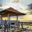 Traditional pavillion on sunset beach — Stock Photo