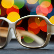 White plastic sunglasses. Funny bokeh — Stock Photo