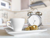 Cup of coffee in a kitchen — Stock Photo