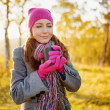 Young woman enjoying the fall season. Autumn outdoor portrait — Stock Photo #34990341