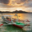 Traditional boats at sunset. Philippines — Stock Photo