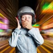 Stock Photo: Funny girl in helmet moving on street