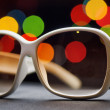 White plastic sunglasses. Funny bokeh — Photo