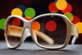 White plastic sunglasses. Funny bokeh — Stock Photo