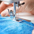 Sewing machine and jeans fabric — Stock Photo #37133443