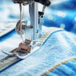 Sewing machine and jeans fabric — Stock Photo #37133473