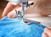 Sewing machine and jeans fabric — Stock Photo