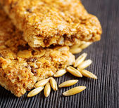 Oat granola bars on wooden table — Stock Photo