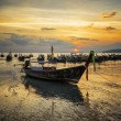 Traditional thai boats at sunset beach. Ao Nang, Krabi province — Stock Photo