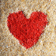 Red heart sign in yellow sand — Stock Photo #38773209