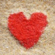 Red heart sign in yellow sand — Stock Photo #39262247