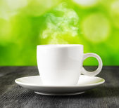 Cup of coffee on nature background — Foto de Stock