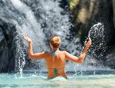 Young woman relaxing in waterfall — Stock Photo