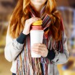 Stock Photo: Young womholding tumbler of coffee