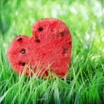 Watermelon heart on green grass. Valentine concept — Stock Photo #39766347