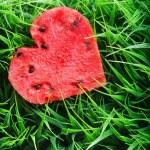 Watermelon heart on green grass. Valentine concept — Stock Photo #39766355